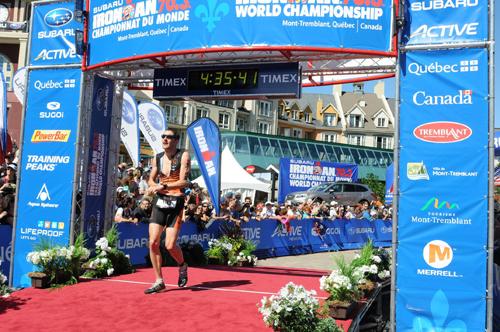Chris finishing at the 2014 70.3 Ironman World Championships